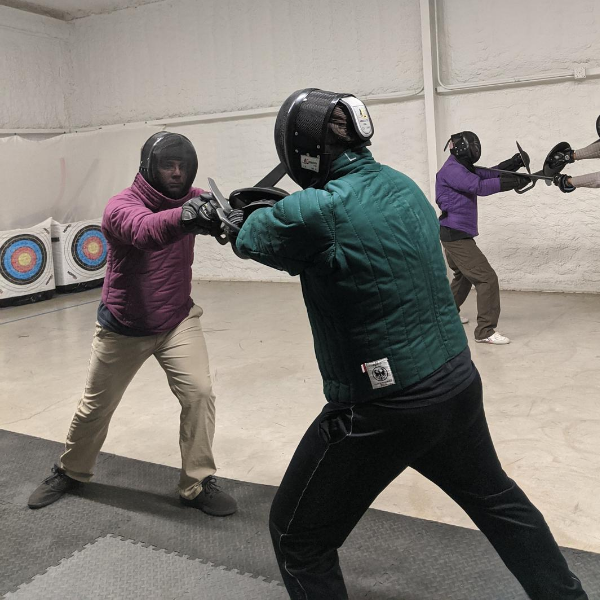 Foundations fight training, a group of students working on sword and buckler drills.